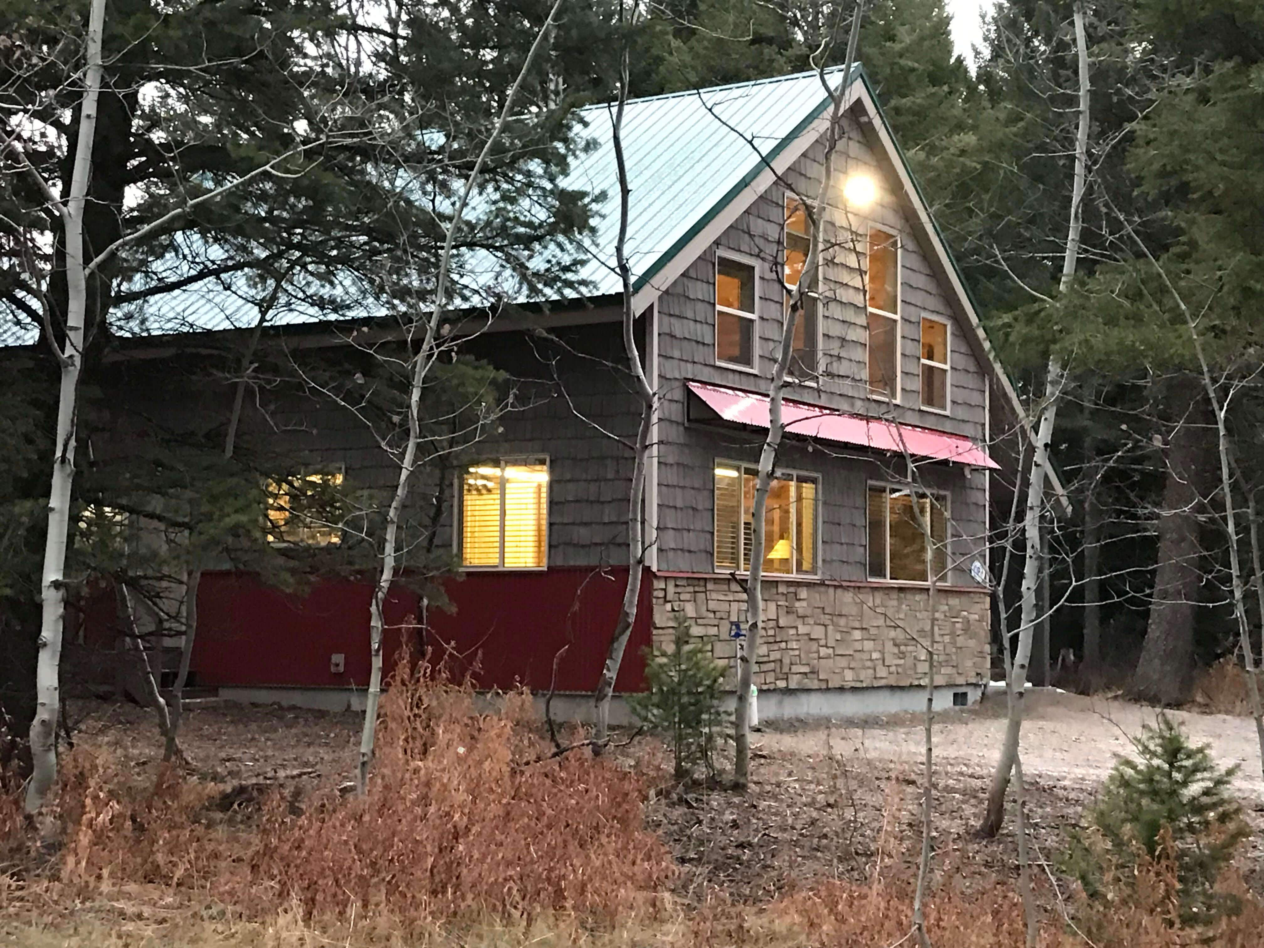Island Park property management Aspen Cabin surronded by tress